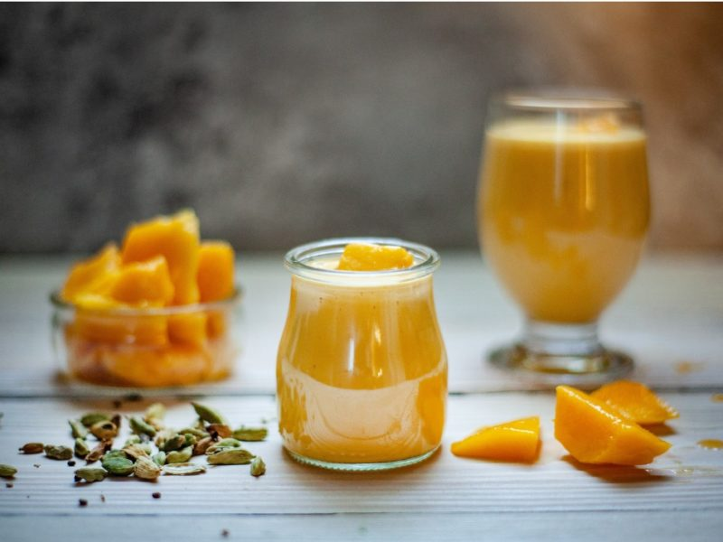 This photograph shows mango sauce in a jar.